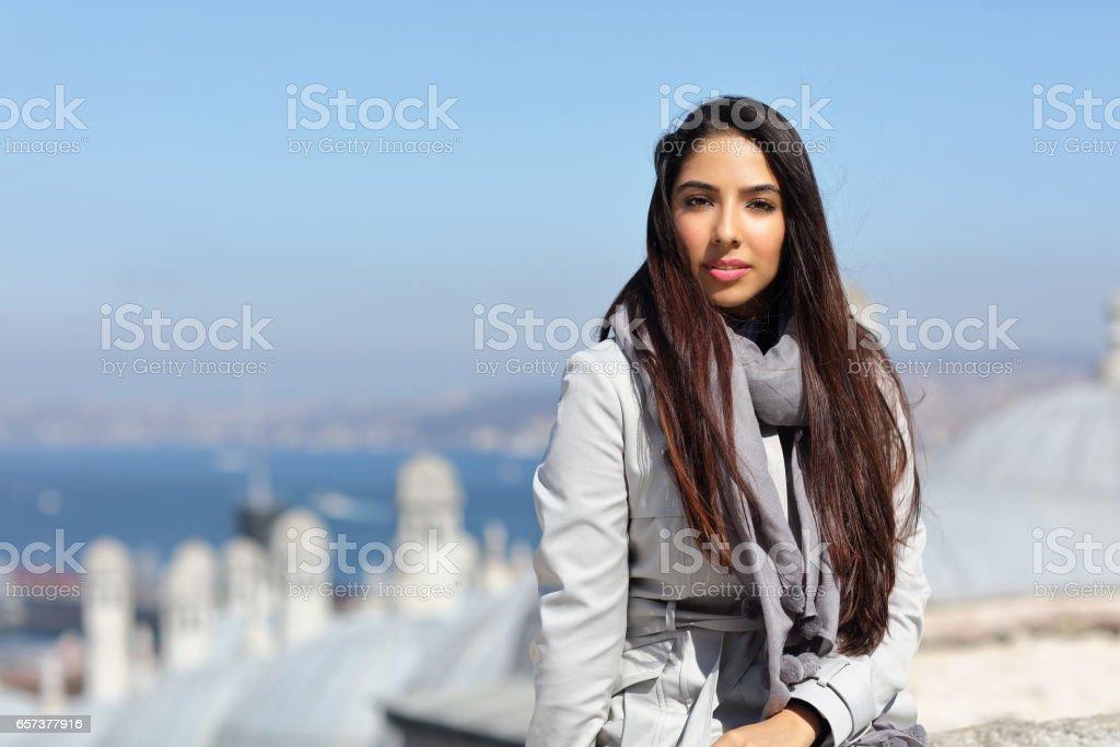 Beautiful woman sitting out the Suleymaniye Mosque enjoying the amazing view of Istanbul, Turkey stock photo