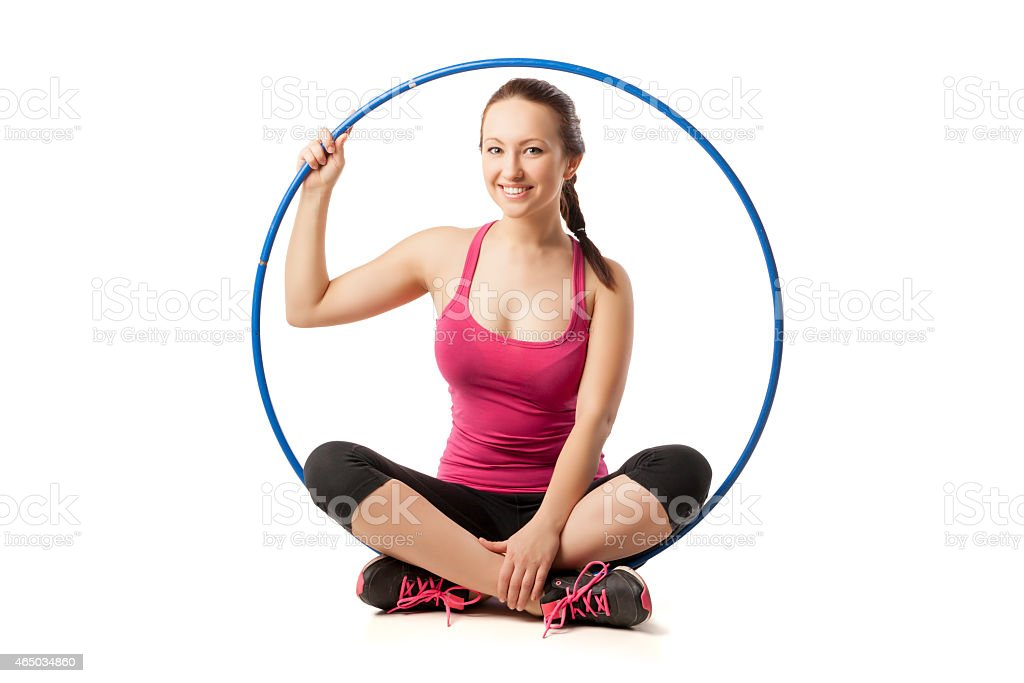 Beautiful woman sitting with color hula hoop stock photo