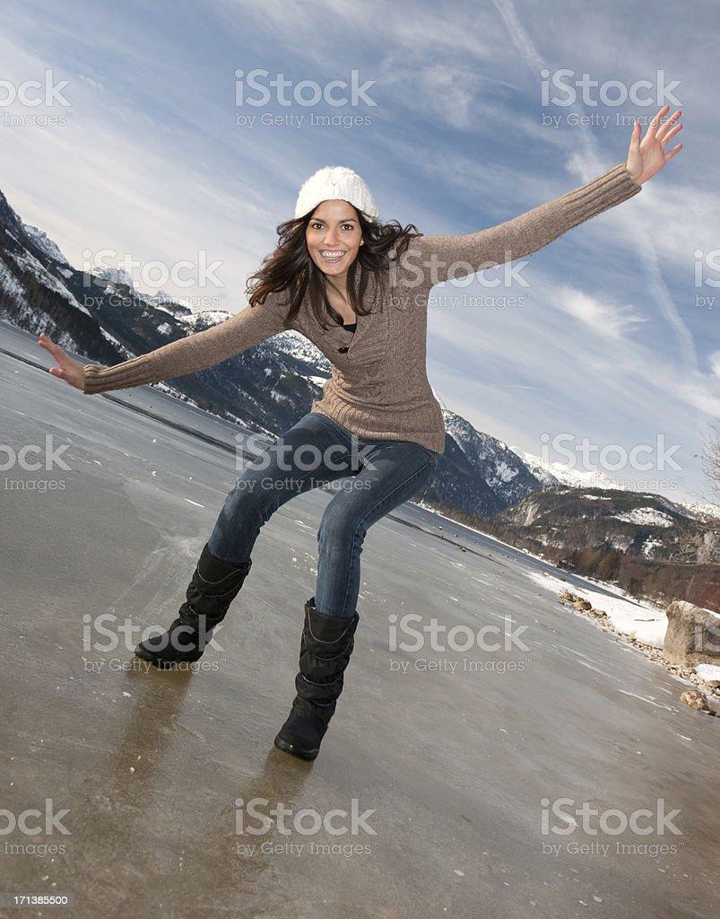 Beautiful woman skidding on a frozen Lake (XXXL) royalty-free stock photo