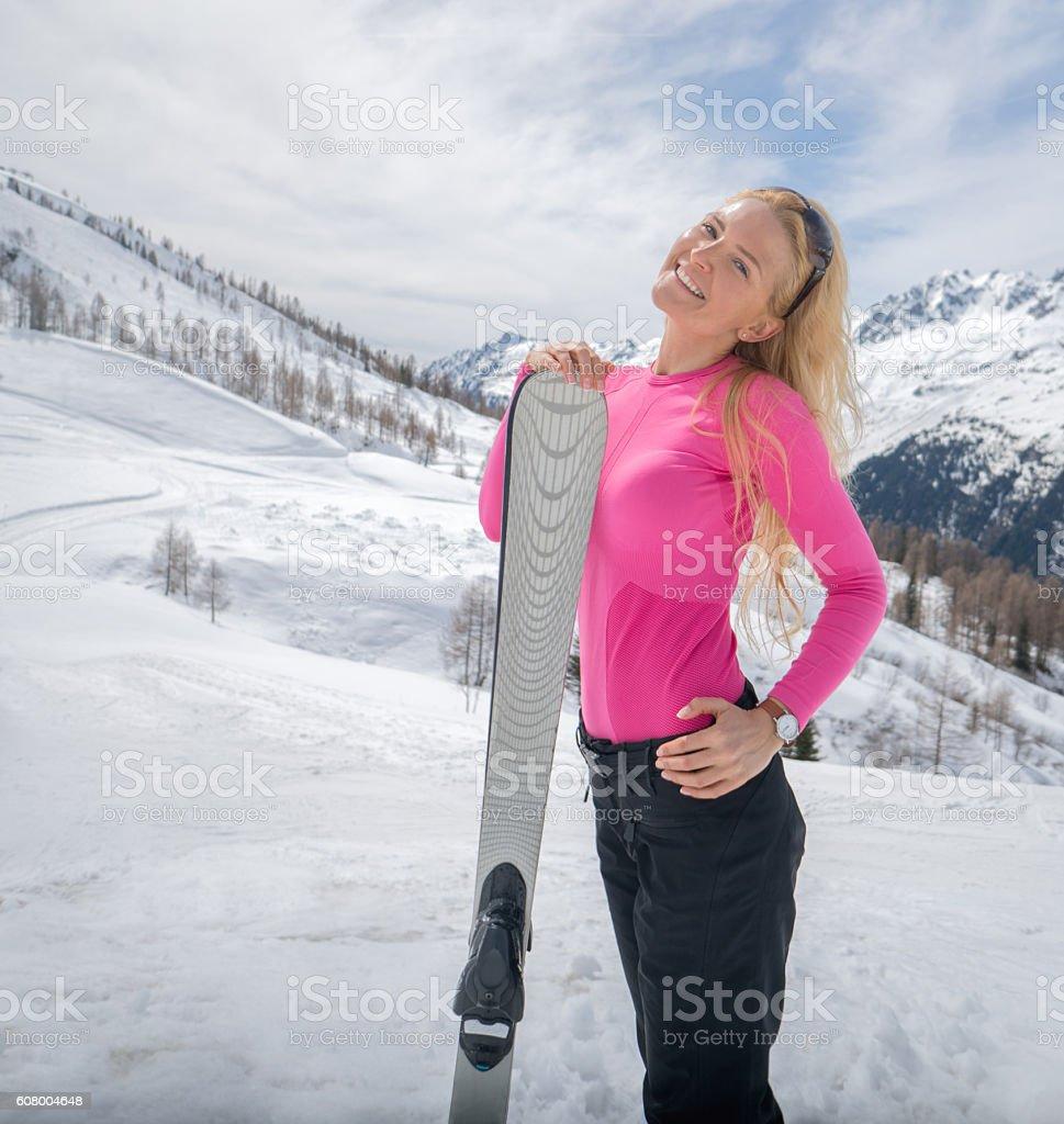 Beautiful woman skiing stock photo