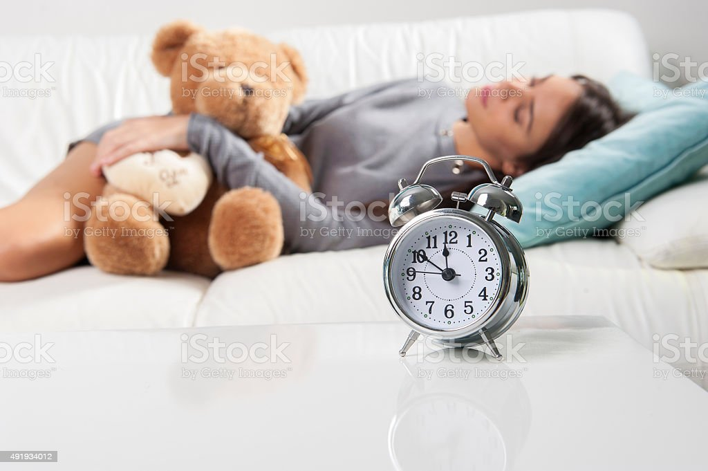 beautiful woman sleeping on a couch stock photo