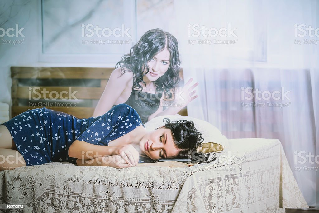 Beautiful woman sleeping on the bed, the soul left stock photo