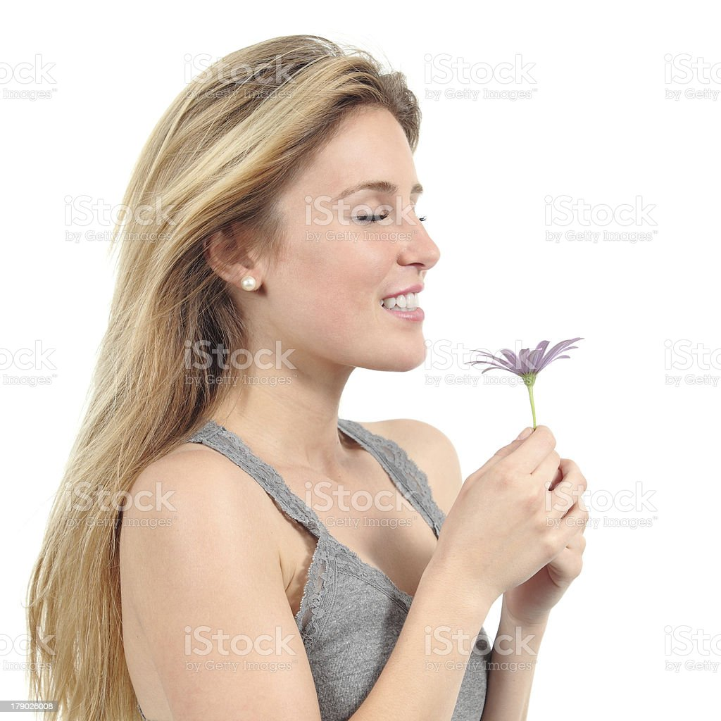 Beautiful woman smelling a lilac daisy royalty-free stock photo