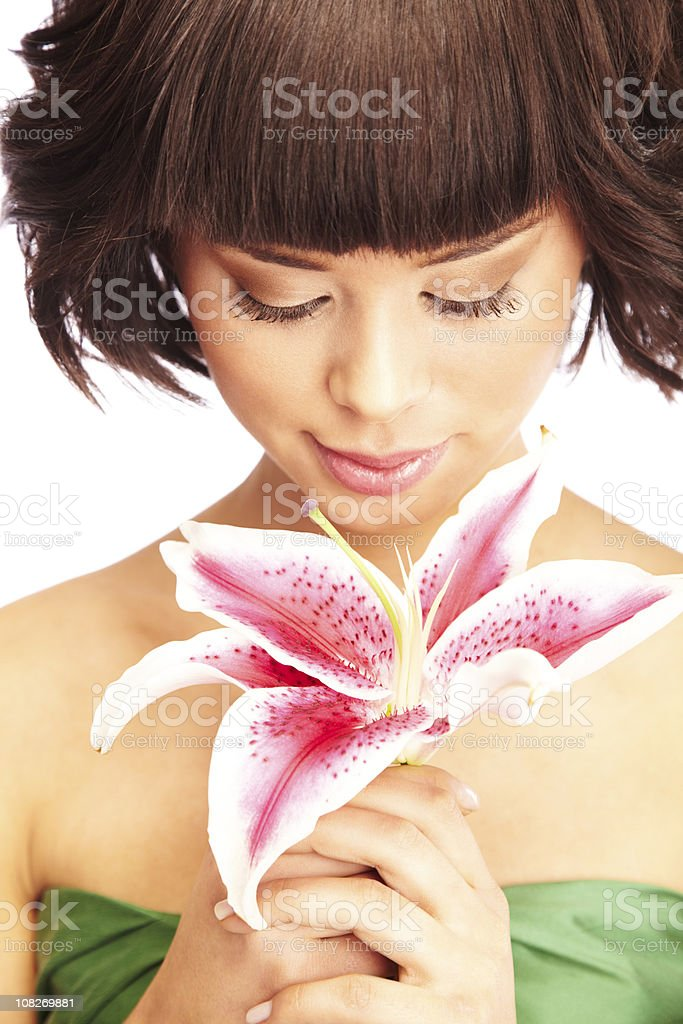 Beautiful Woman Smelling an pink lily flower royalty-free stock photo