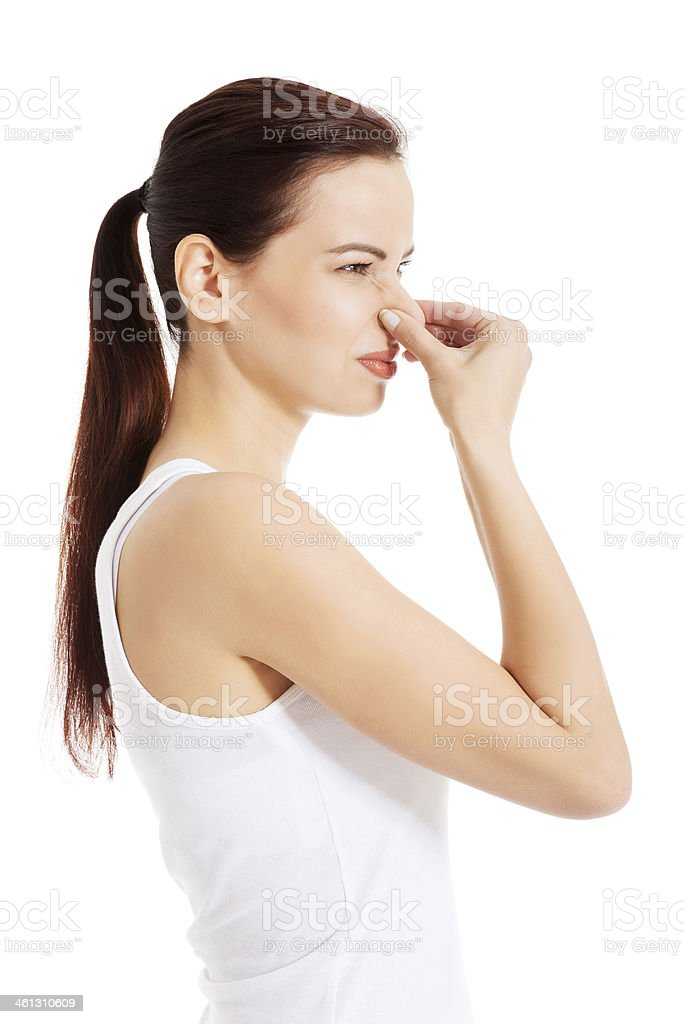 Beautiful woman smells bad scent. royalty-free stock photo