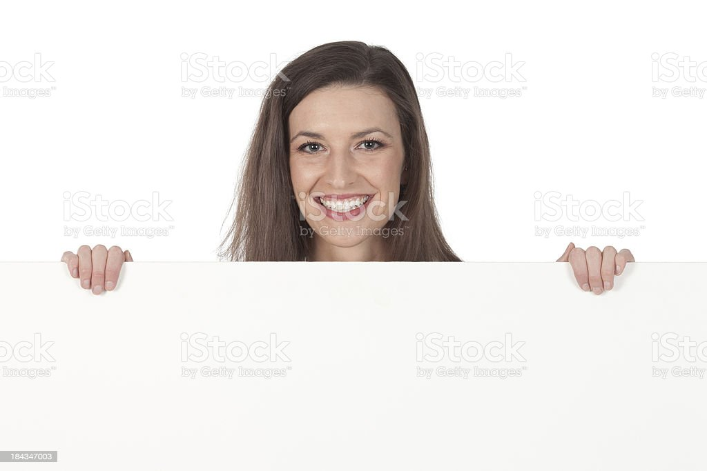 Beautiful woman smiling behind a placard stock photo