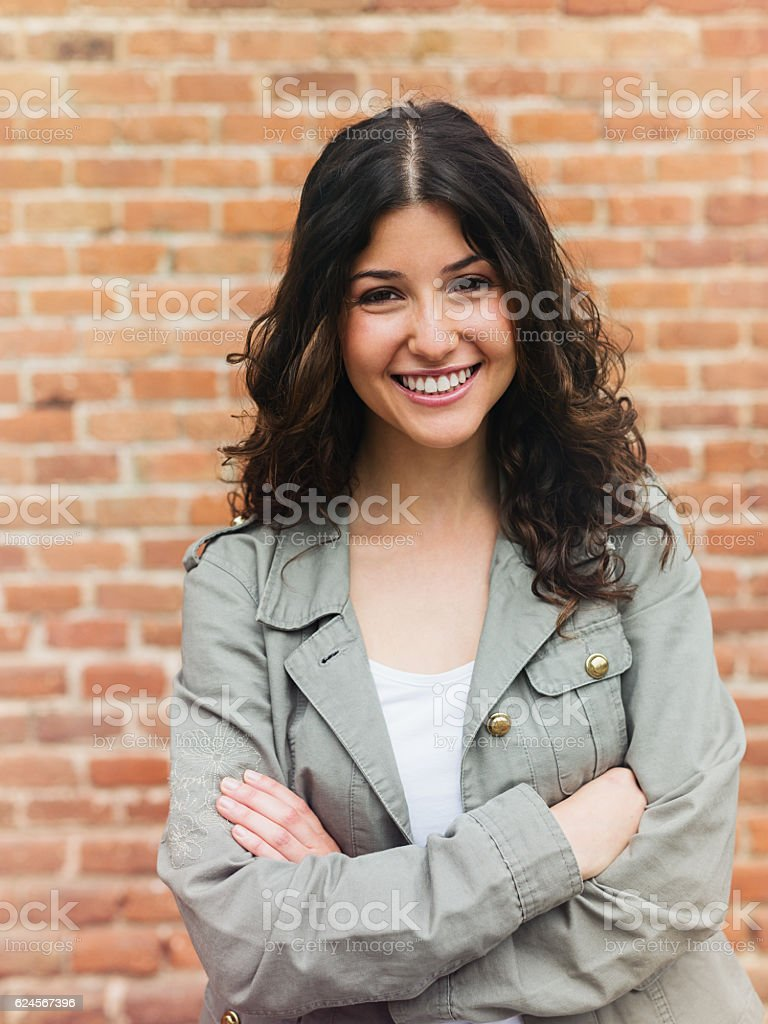 Beautiful woman smiling in the street stock photo