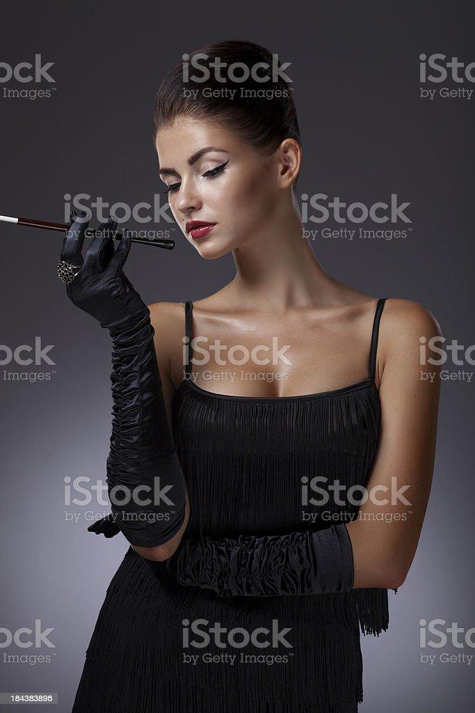 Beautiful woman smoking her cigarette royalty-free stock photo