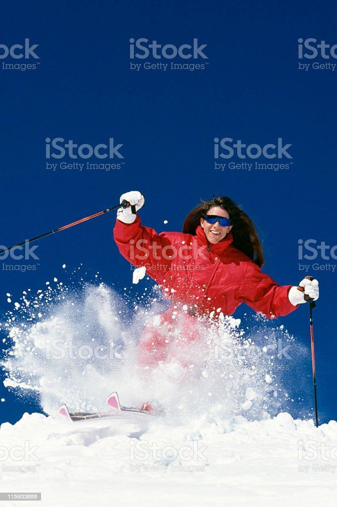 Beautiful Woman Snow Skiing royalty-free stock photo