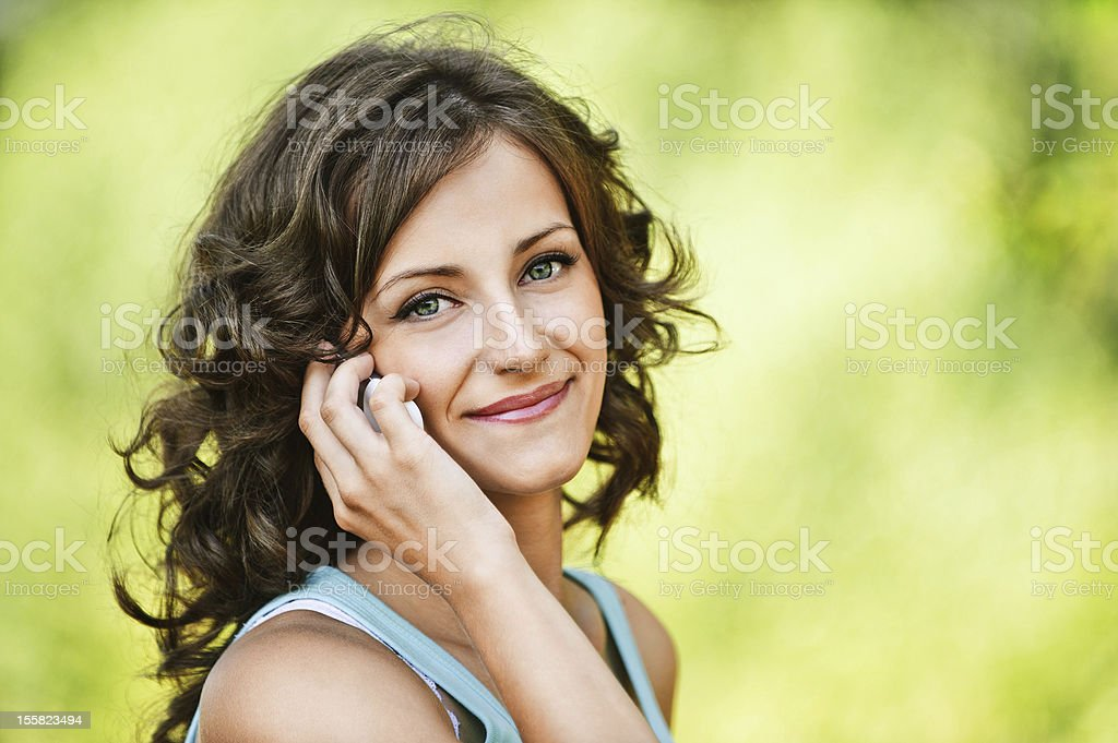 beautiful woman speaking on mobile phone royalty-free stock photo