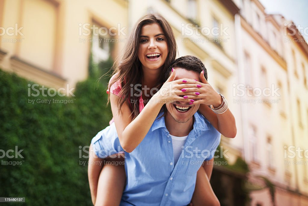Beautiful woman spending funny time with her boyfriend stock photo