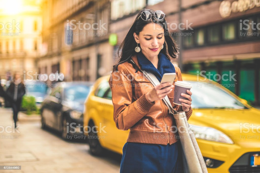 Beautiful woman spending time in the city stock photo