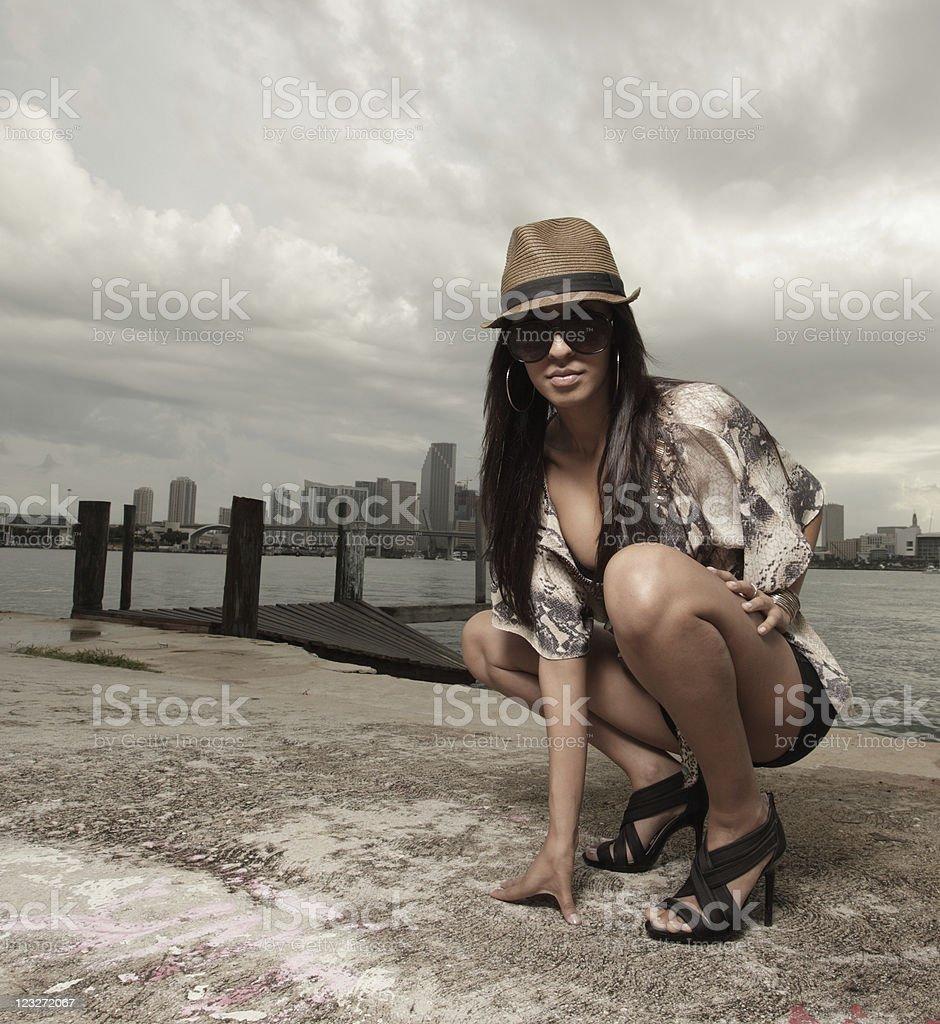 Beautiful woman squatting royalty-free stock photo