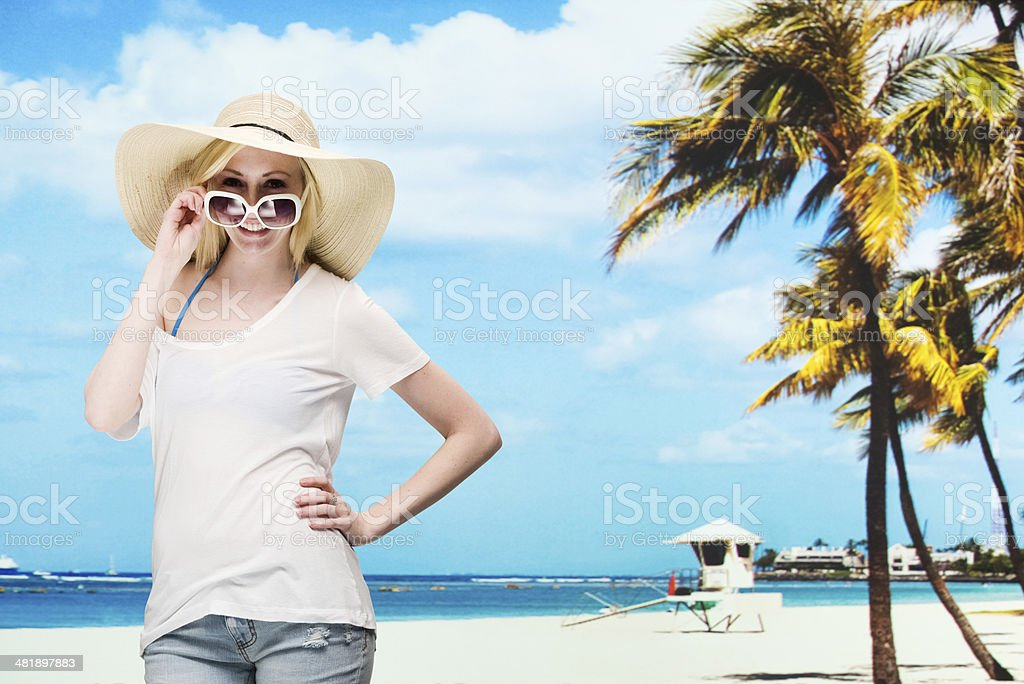 Beautiful woman standing in front of beach royalty-free stock photo