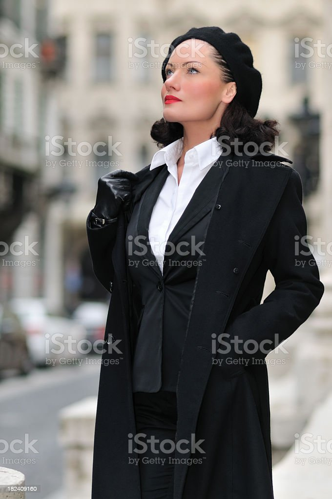 Beautiful woman standing on the street royalty-free stock photo