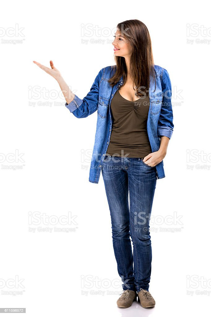 Beautiful woman standing over a white background and stock photo