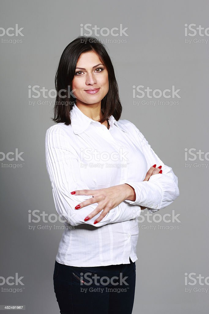 beautiful woman standing with arms holding stock photo