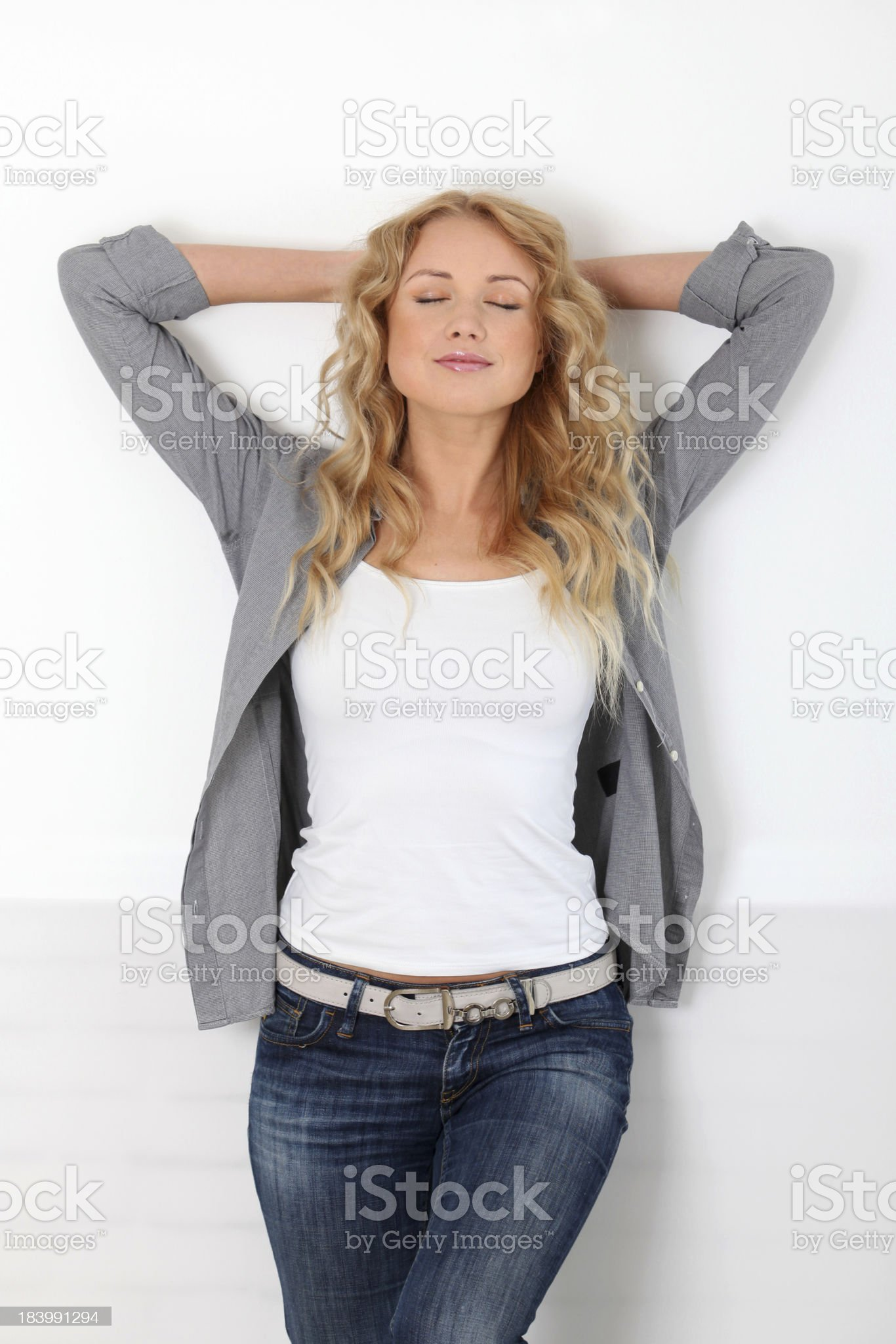 Beautiful woman standing with hands under head royalty-free stock photo