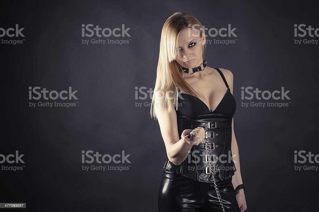 beautiful woman standing with master leash stock photo