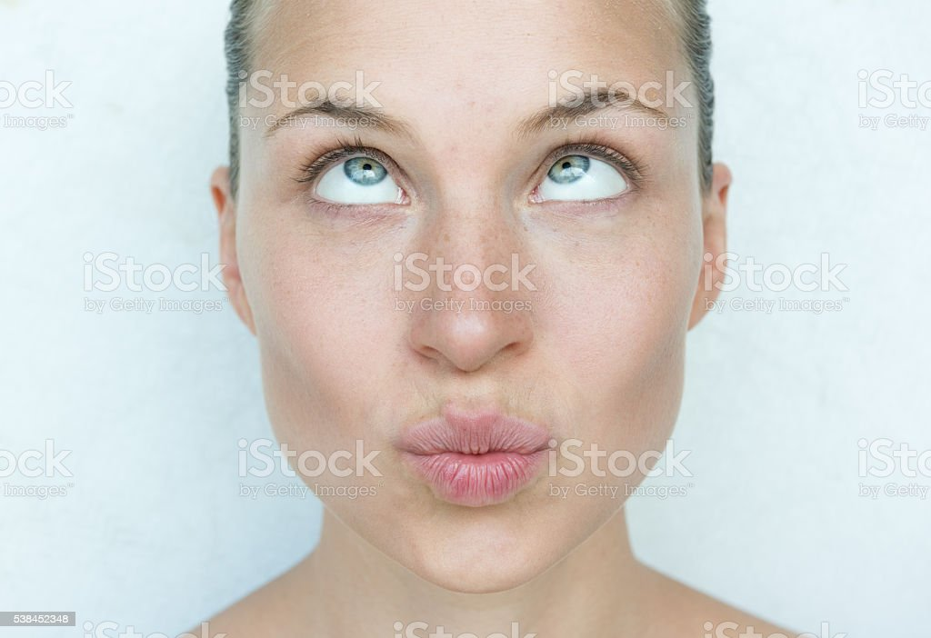 Beautiful Woman staring up at her forehead, Funny stock photo