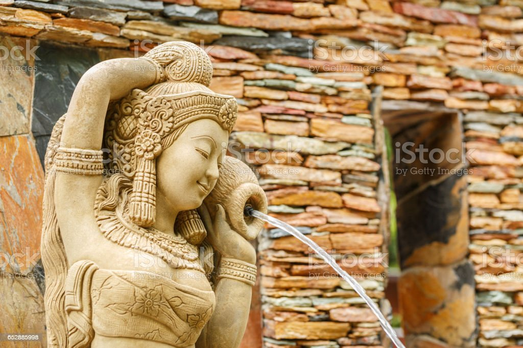 Beautiful woman statue  at stone garden in Thailand stock photo