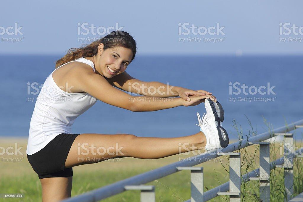 Beautiful woman stretching legs looking at camera royalty-free stock photo