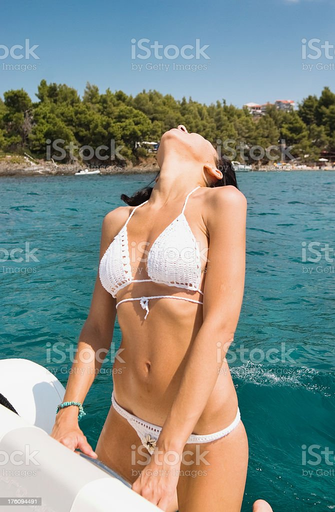 Beautiful woman sunbathing on a boat royalty-free stock photo