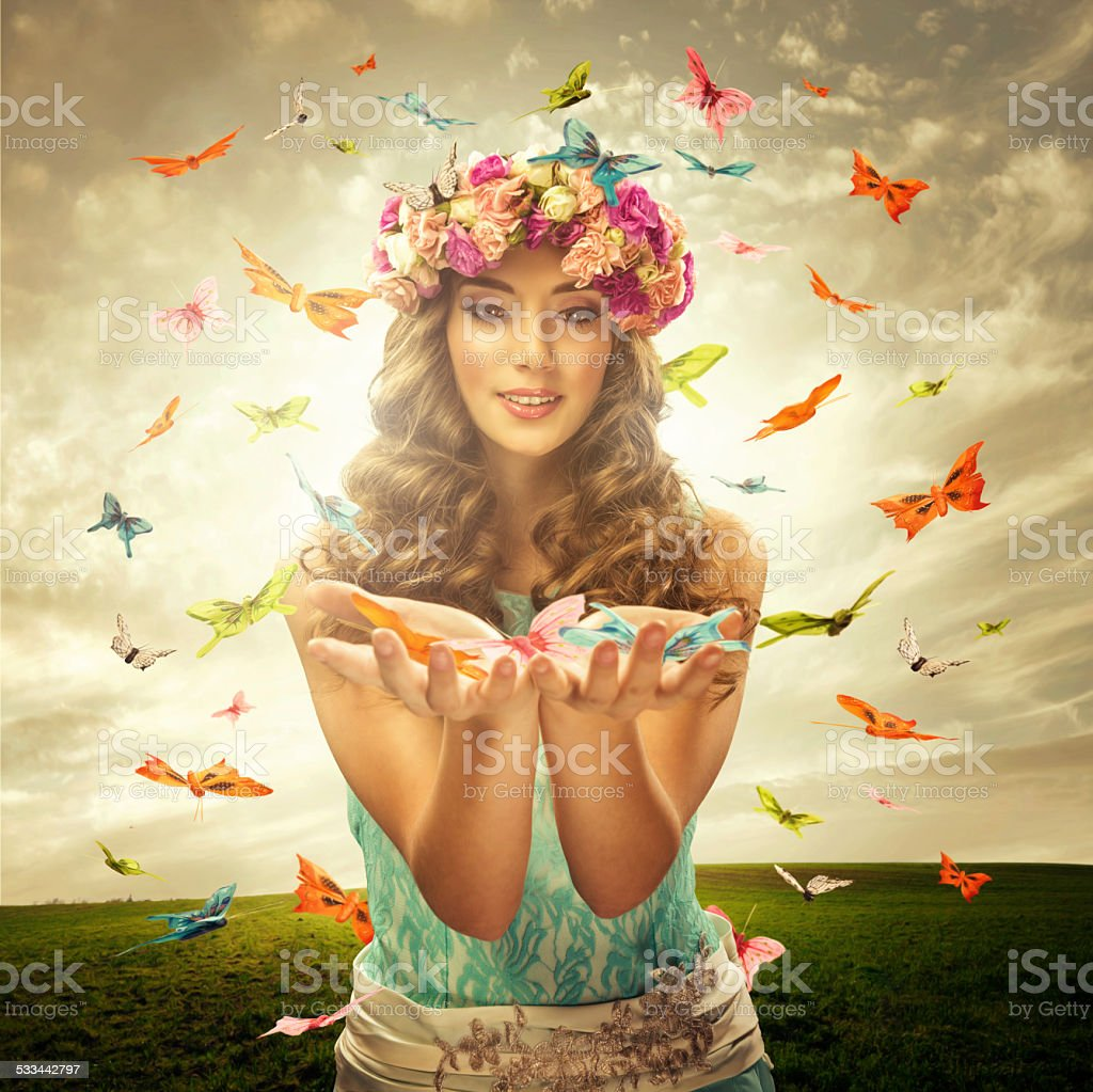 Beautiful woman surrounds many butterfly stock photo