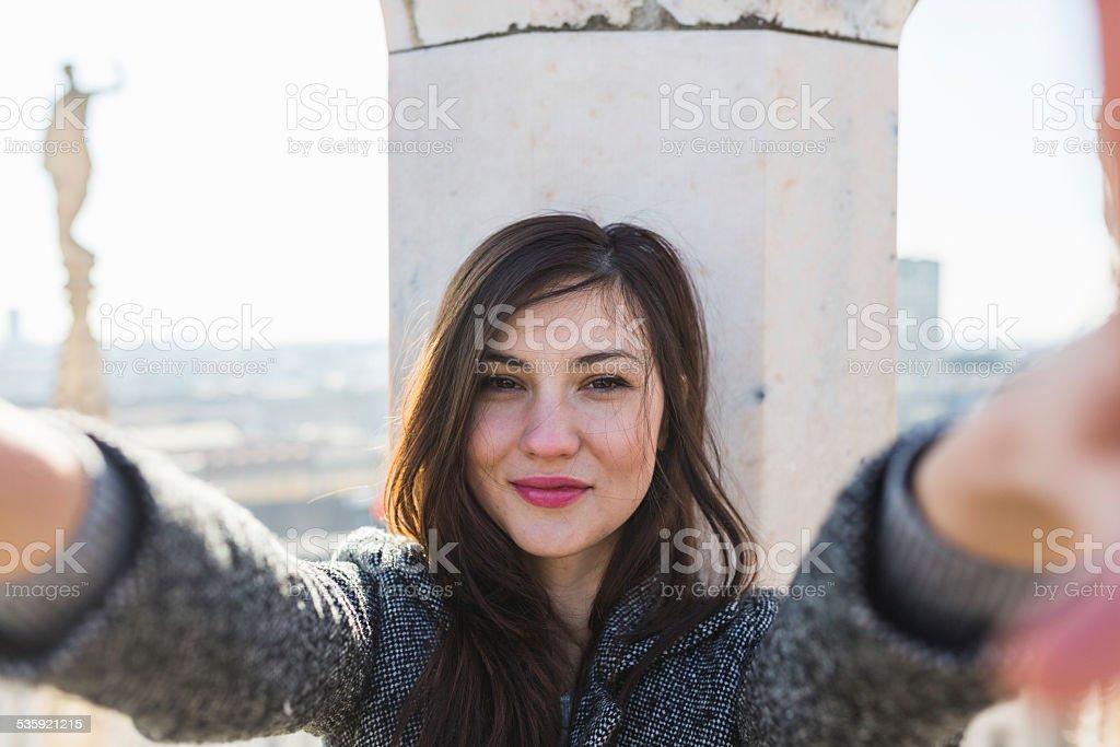 Beautiful woman takes a selfie stock photo