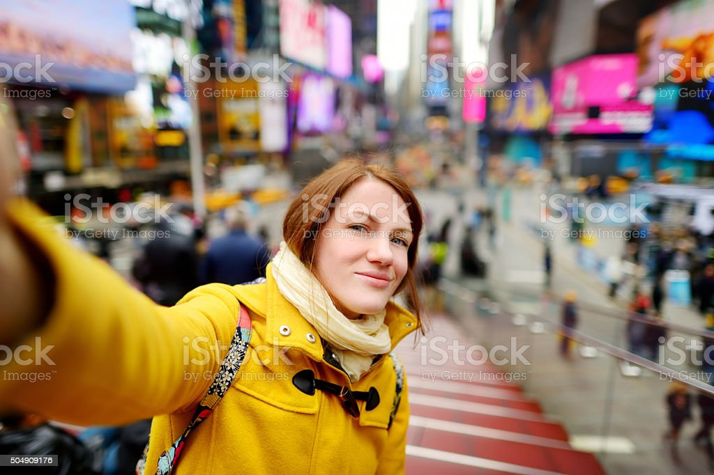 Beautiful woman taking a selfie on Times Square stock photo