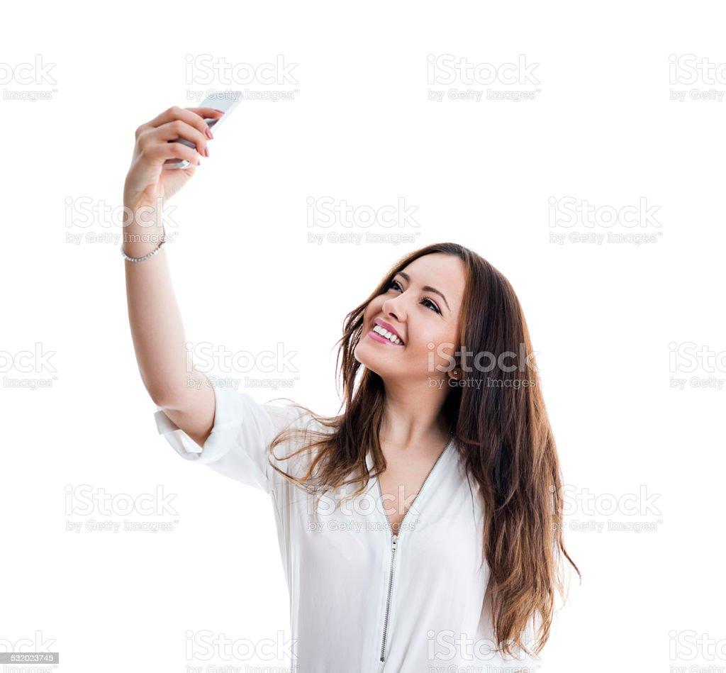 Beautiful woman taking a selfie stock photo