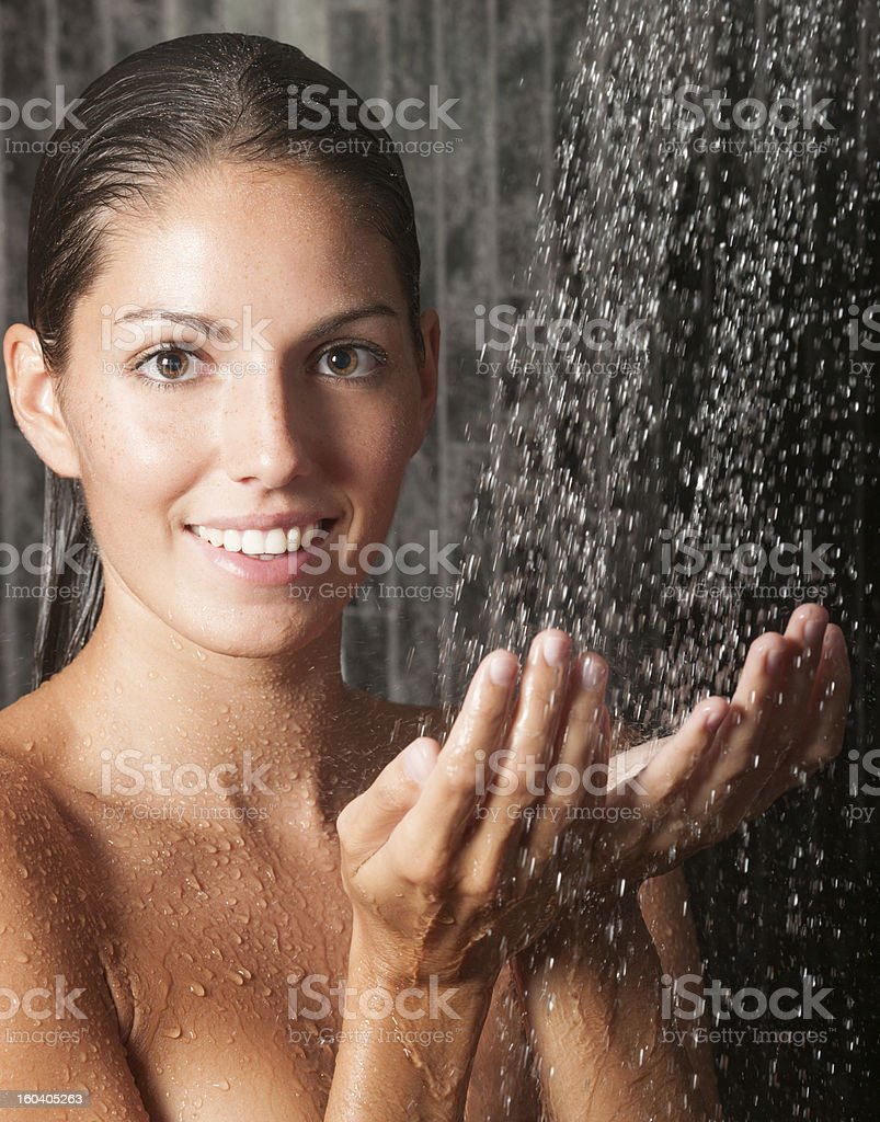 Beautiful woman taking a shower royalty-free stock photo