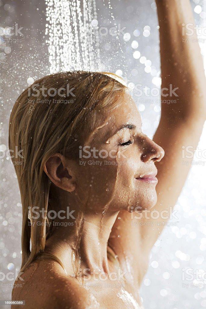Beautiful woman taking a shower. stock photo