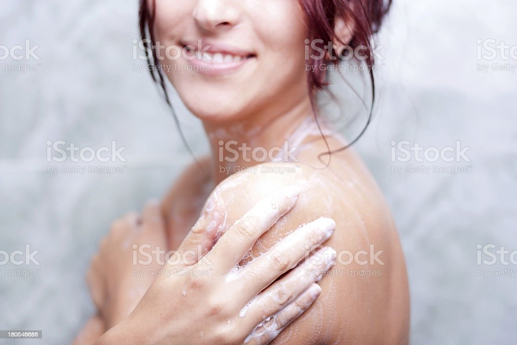 Beautiful woman taking a shower. stock photo
