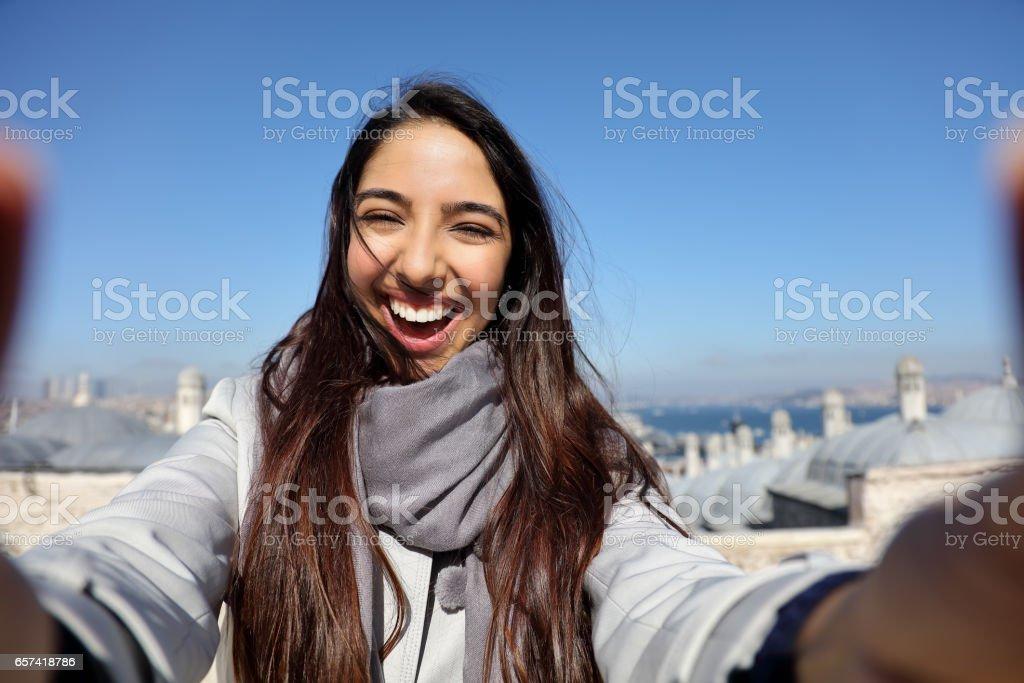 Beautiful woman taking selfie at the Suleymaniye Mosque enjoying the amazing view of Istanbul, Turkey stock photo