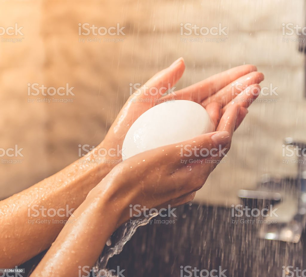 Beautiful woman taking shower stock photo