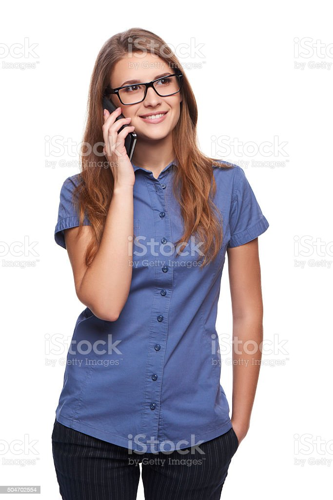 Beautiful woman talking at cell phone stock photo
