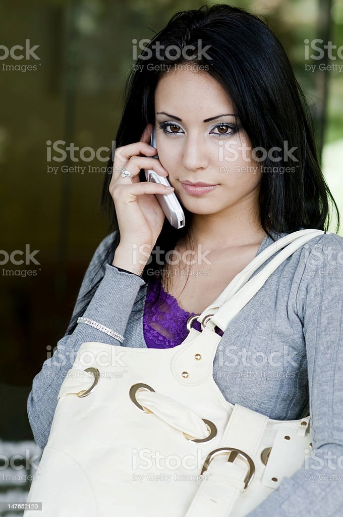 Beautiful woman talking on cell phone royalty-free stock photo