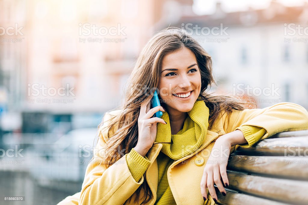 Beautiful woman talking on the phone stock photo