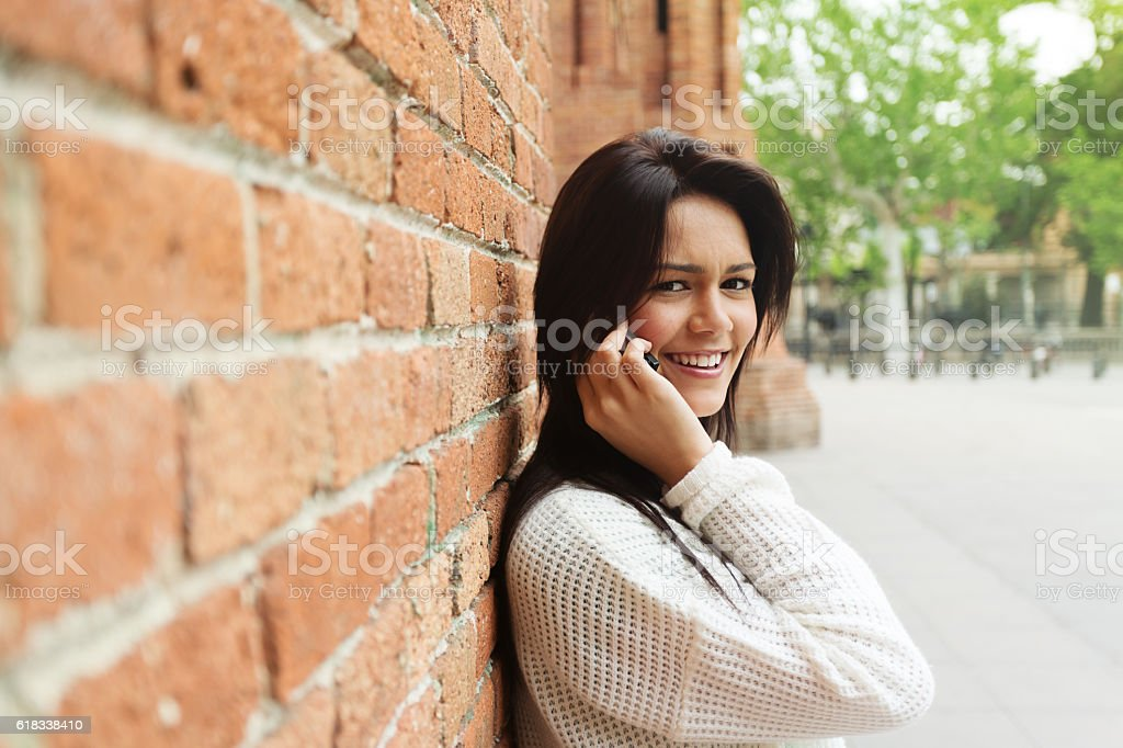Beautiful woman talking using a smartphone stock photo