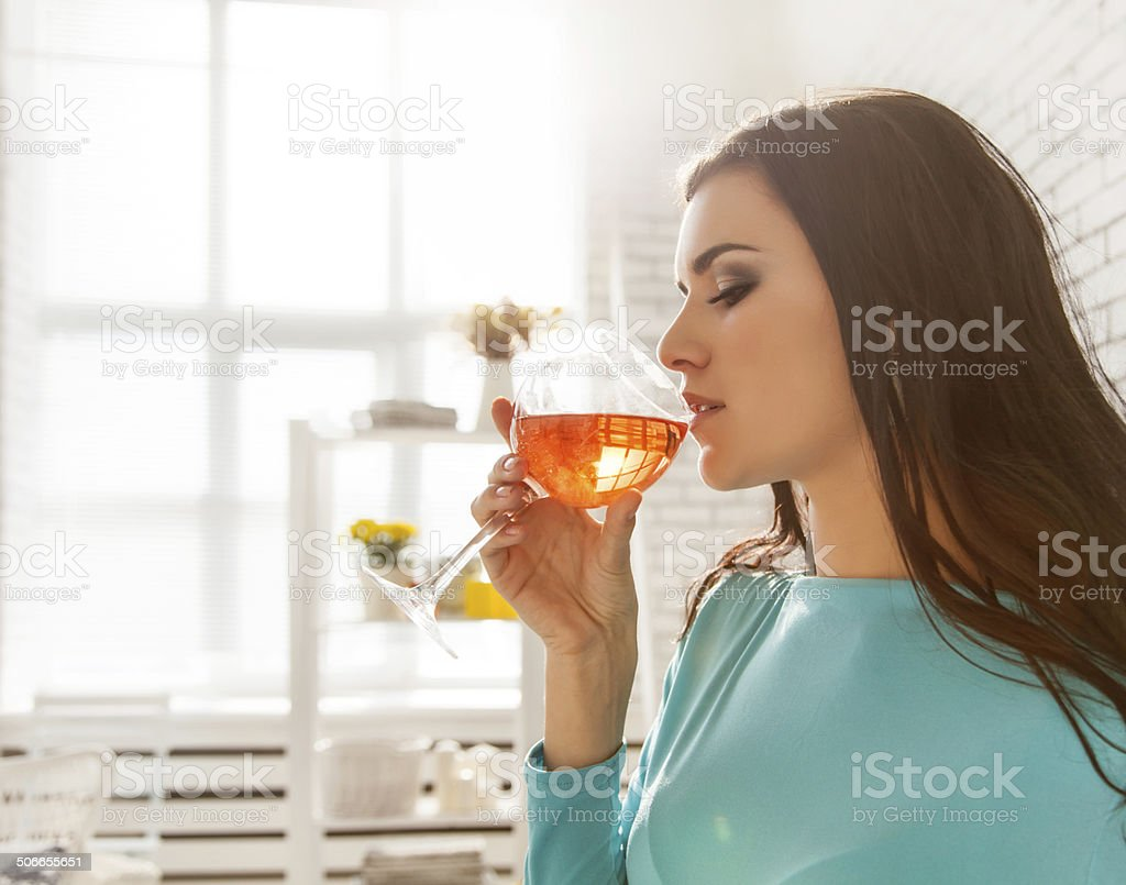 Beautiful woman tasting a glass of rose wine royalty-free stock photo