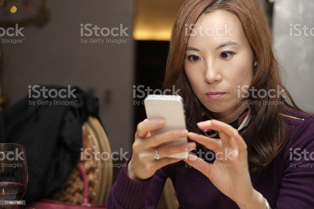 Beautiful woman text messaging royalty-free stock photo