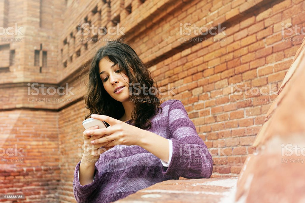 Beautiful woman texting on the phone stock photo