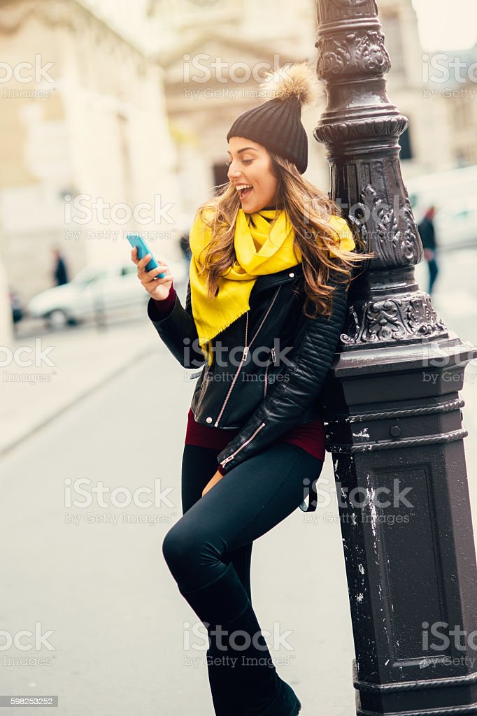 Beautiful woman texting stock photo