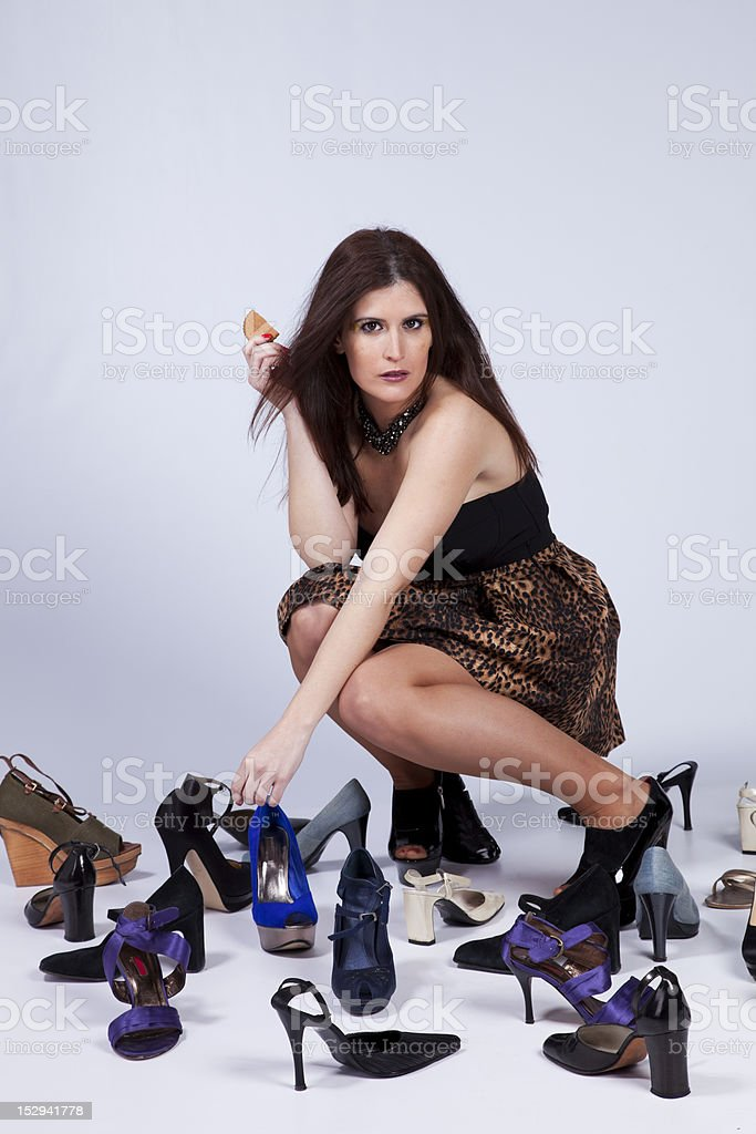 Beautiful woman that loves shoes royalty-free stock photo