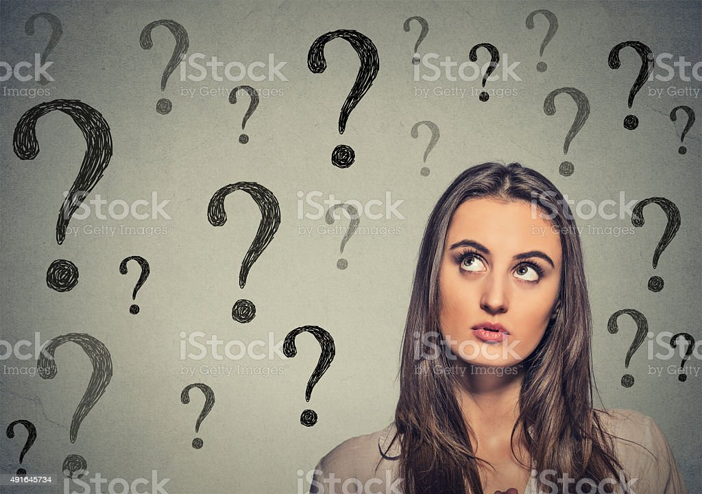 beautiful woman thinking looking up has many questions stock photo