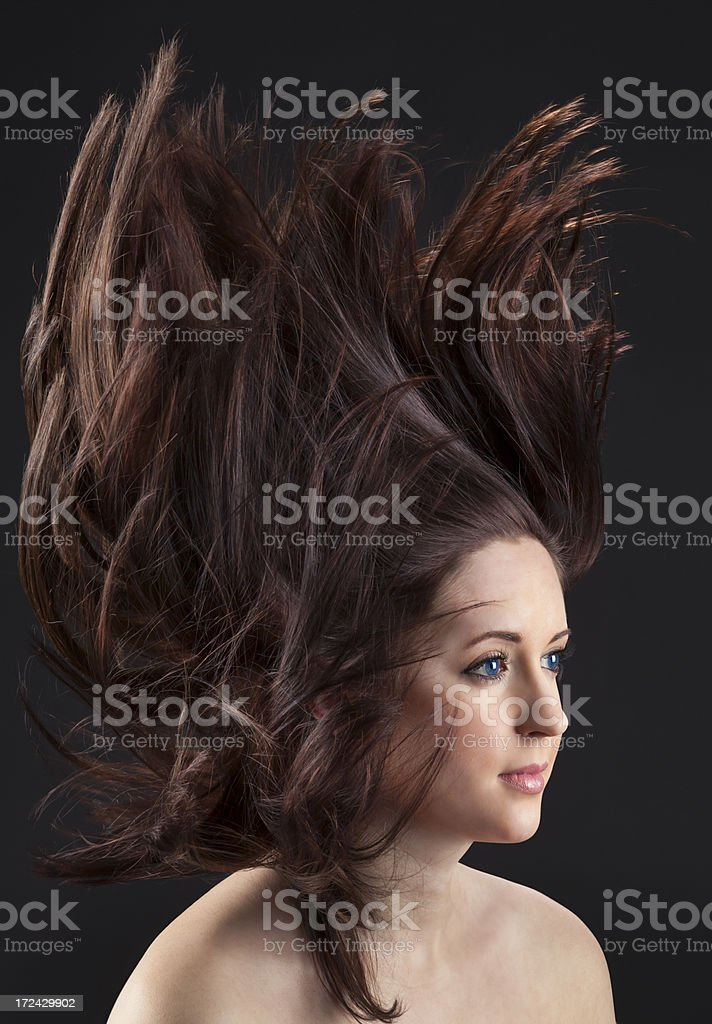 Beautiful Woman Tossing Long Hair Above Her royalty-free stock photo