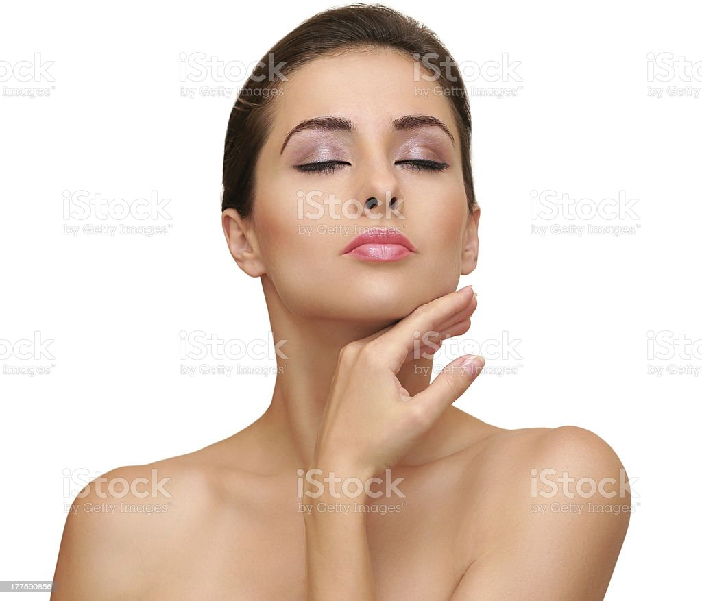 Beautiful woman touching hand her clean skin face isolated royalty-free stock photo