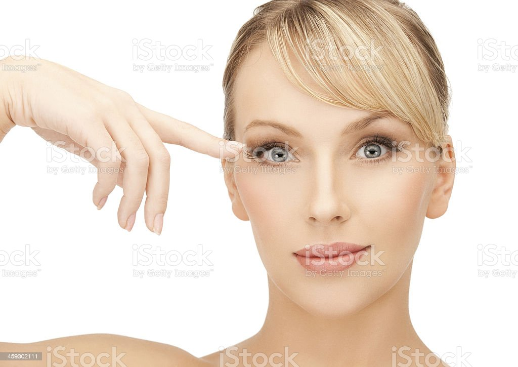 beautiful woman touching her eye area stock photo