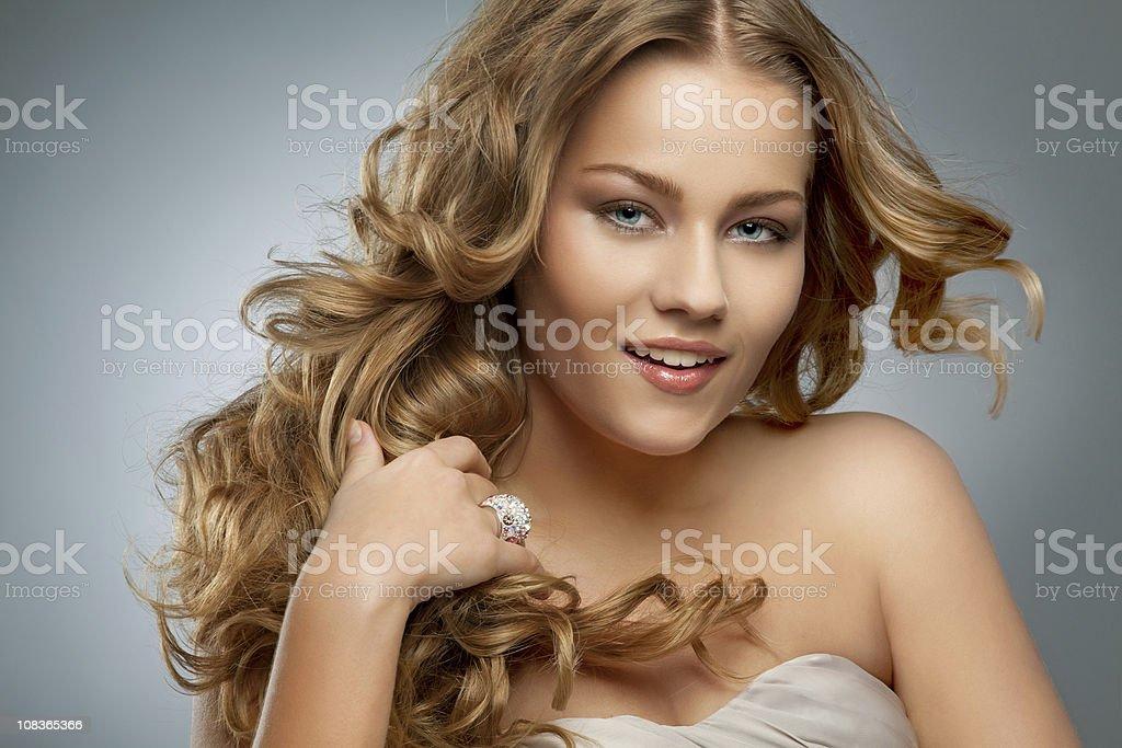 beautiful woman touching her hair royalty-free stock photo
